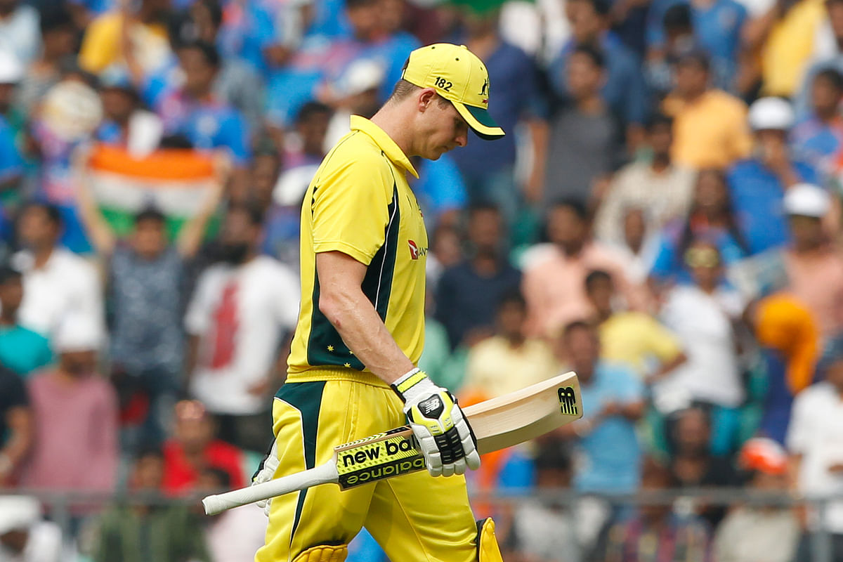 Steve Smith walks back to the pavilion after getting out in the fifth ODI.