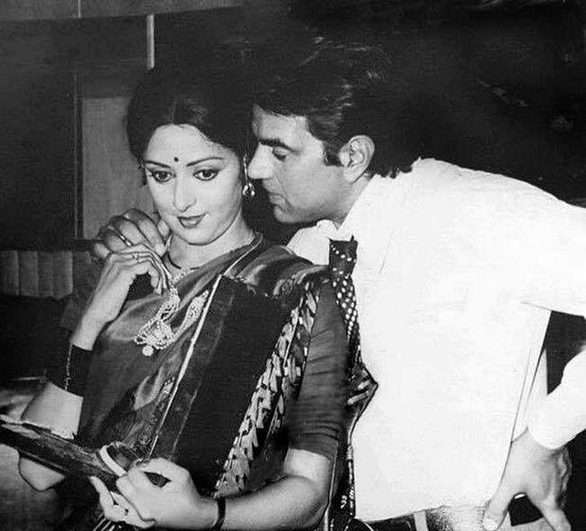 Hema Malini and Dharmendra on the sets of a film.