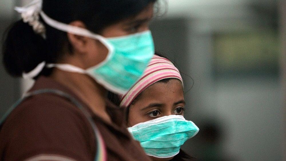 A woman and a child wear masks against air pollution in Delhi.
