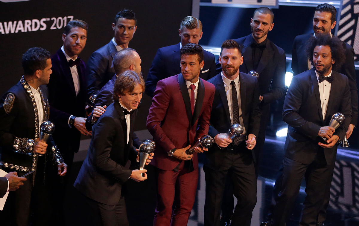 The FIFA FIFPro World 11 award winners and soccer players receive their awards during The Best FIFA 2017 Awards at the Palladium Theatre in London.