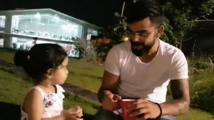 Ziva Dhoni with Virat Kohli.