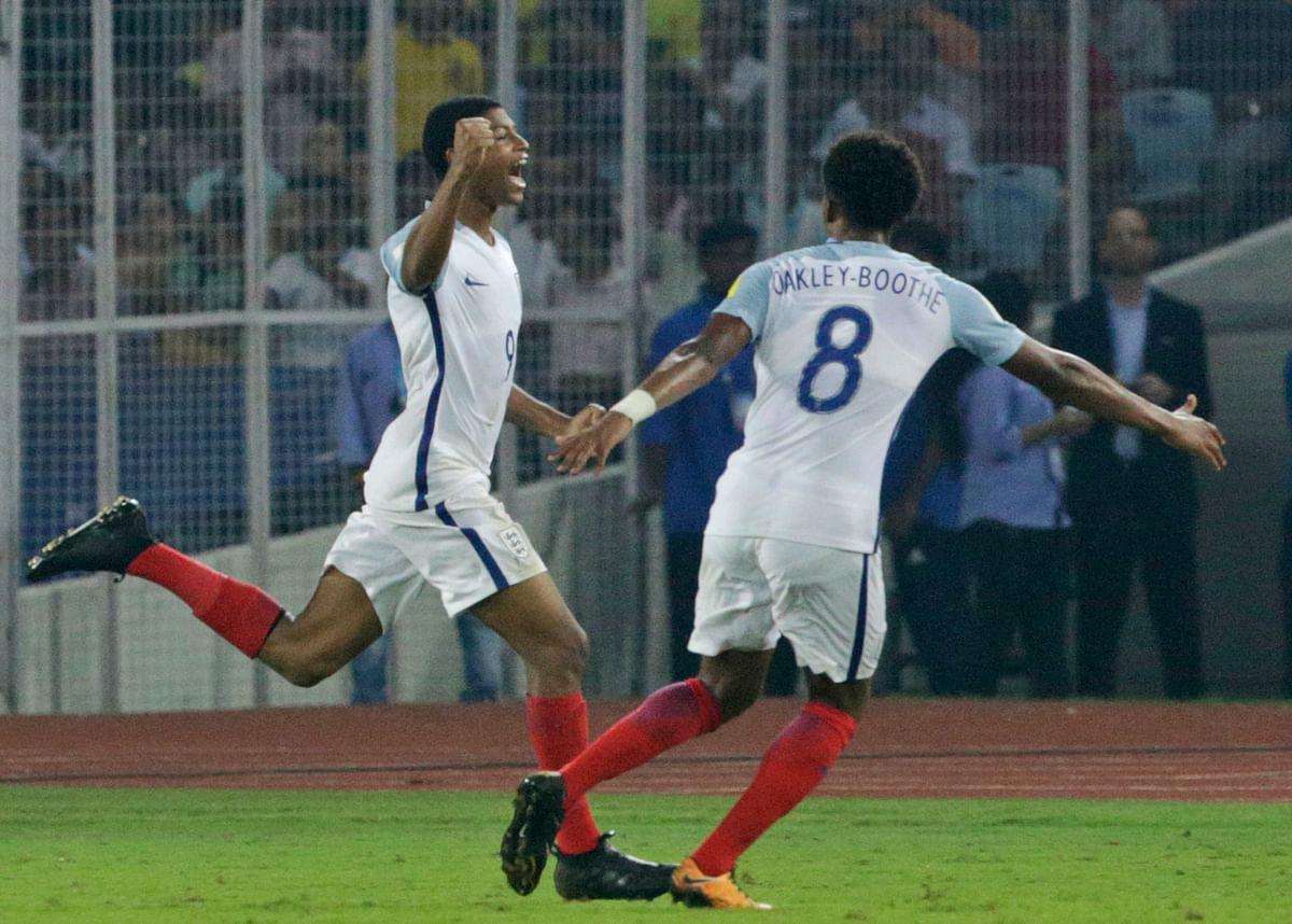 England's Rhian Brewster, left, celebrates a goal against Brazil.