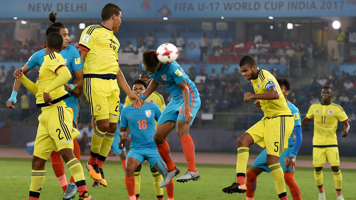 India's Jeakson Singh heads the ball in the goal during the match against Colombia.