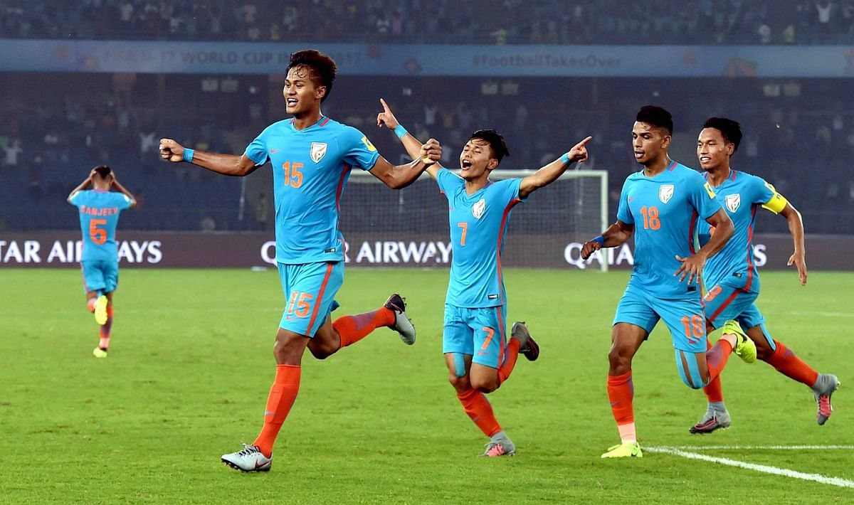 Jeakson Singh celebrates India's first-ever FIFA World Cup goal with his teammates.