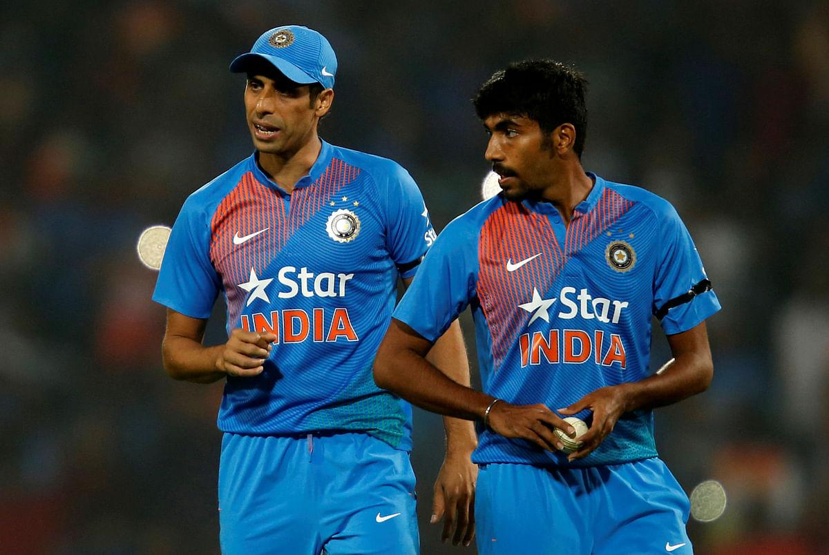Ashish Nehra shares a moment with Jasprit Bumrah.