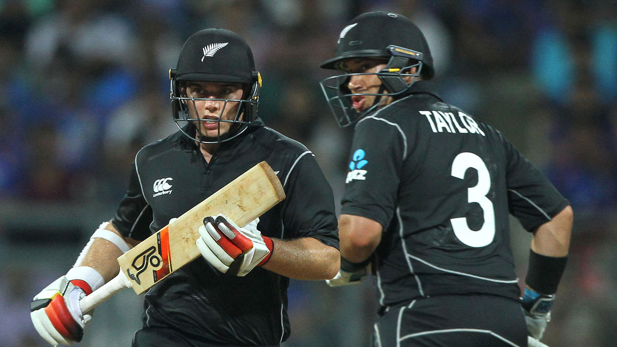 Tom Latham (L) and Ross Taylor (R) take a run during the first ODI.