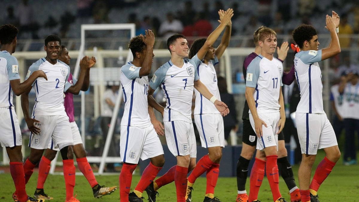 The England team celebrate after beating Brazil.