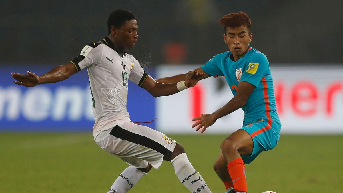 India's Boris Thangjam, right, and Ghana's Gabriel Leveh vie for the ball.