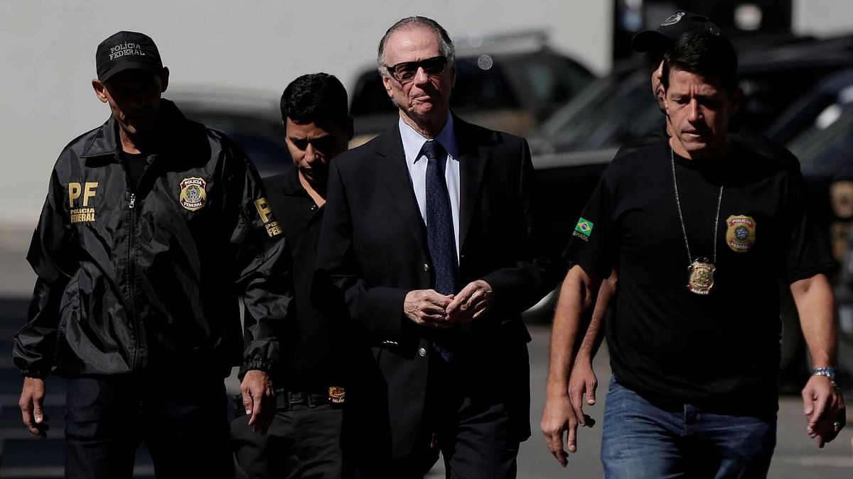 Carlos Arthur Nuzman arrives at Federal Police headquarters in Rio de Janeiro on Thursday.