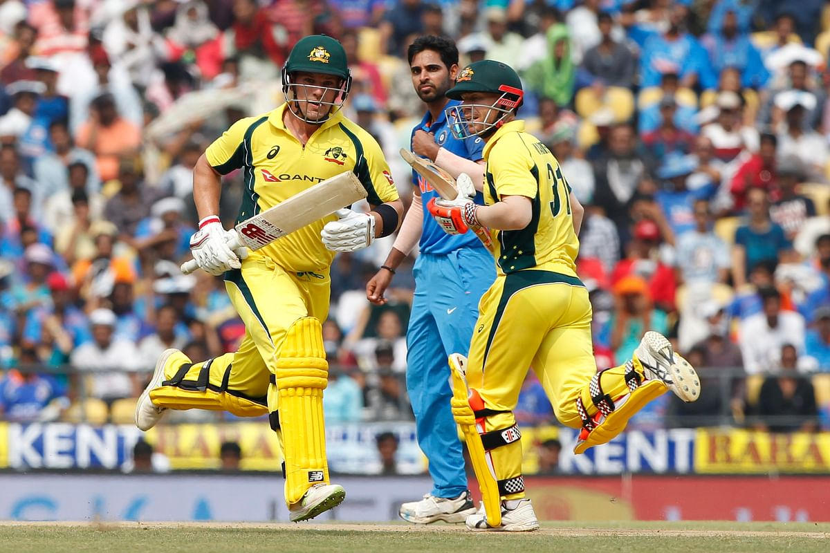 Aaron Finch and David Warner take a run during the fifth ODI against Australia.