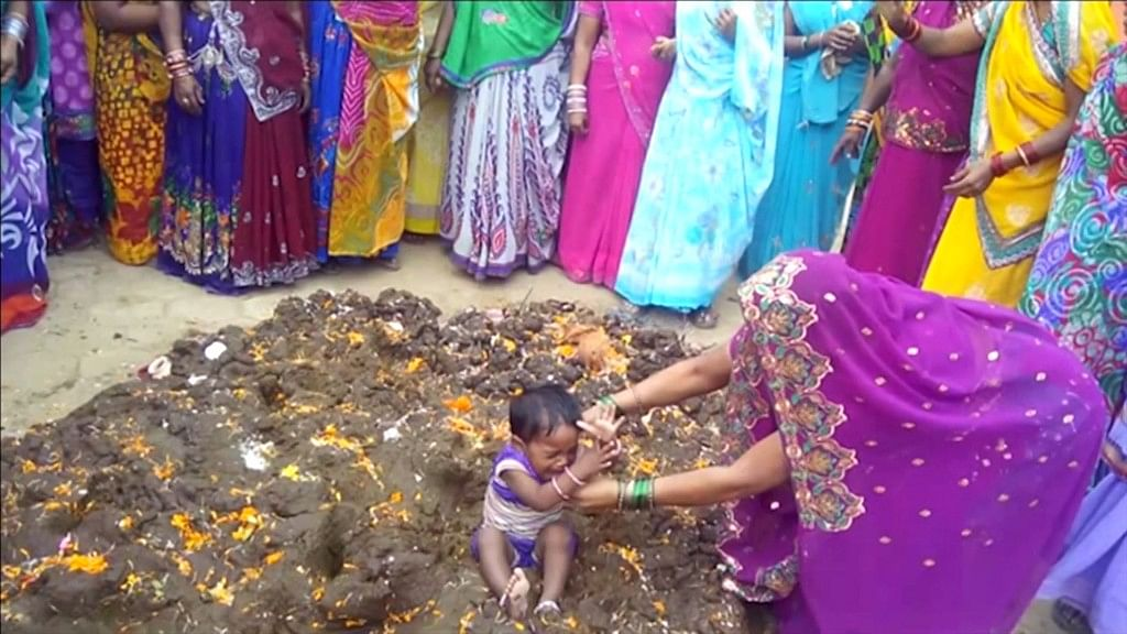 Why Are Parents Rolling  Kids in Cow Dung? Well, It's Tradition!