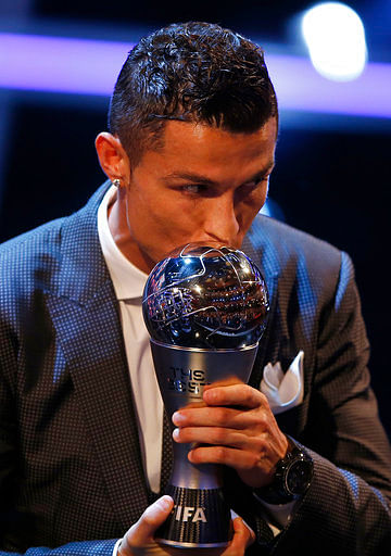 Portuguese soccer player Christiano Ronaldo holds the Best FIFA Men's player award during The Best FIFA 2017 Awards at the Palladium Theatre in London.