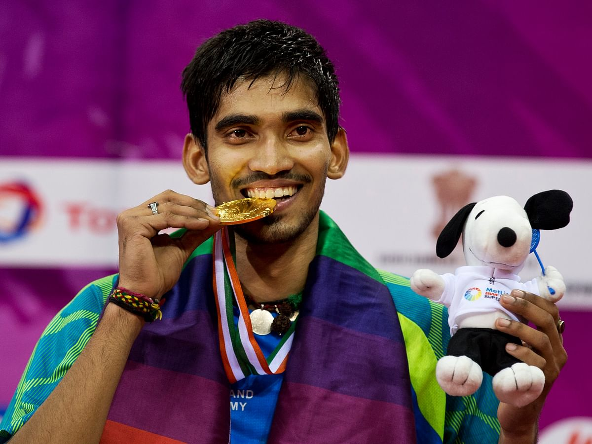 Kidambi Srikanth displays his gold medal after winning the men's singles final of Yonex Sunrise India Open Badminton in New Delhi, on 29 March 2015.
