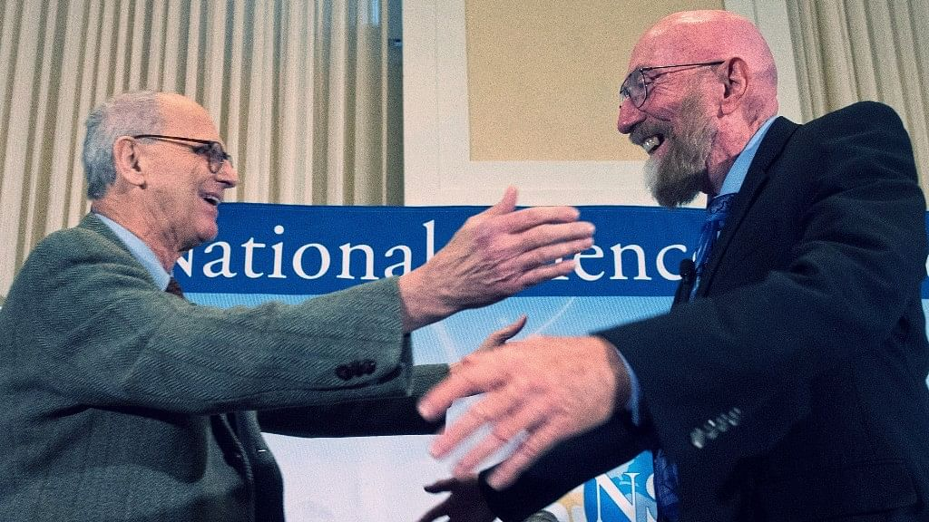 Laser Interferometer Gravitational-Wave Observatory (LIGO) co-founder Rainer Weiss and Kip Thorne hug on stage during a news conference at the National Press Club in Washington, USA. (Photo: AP)