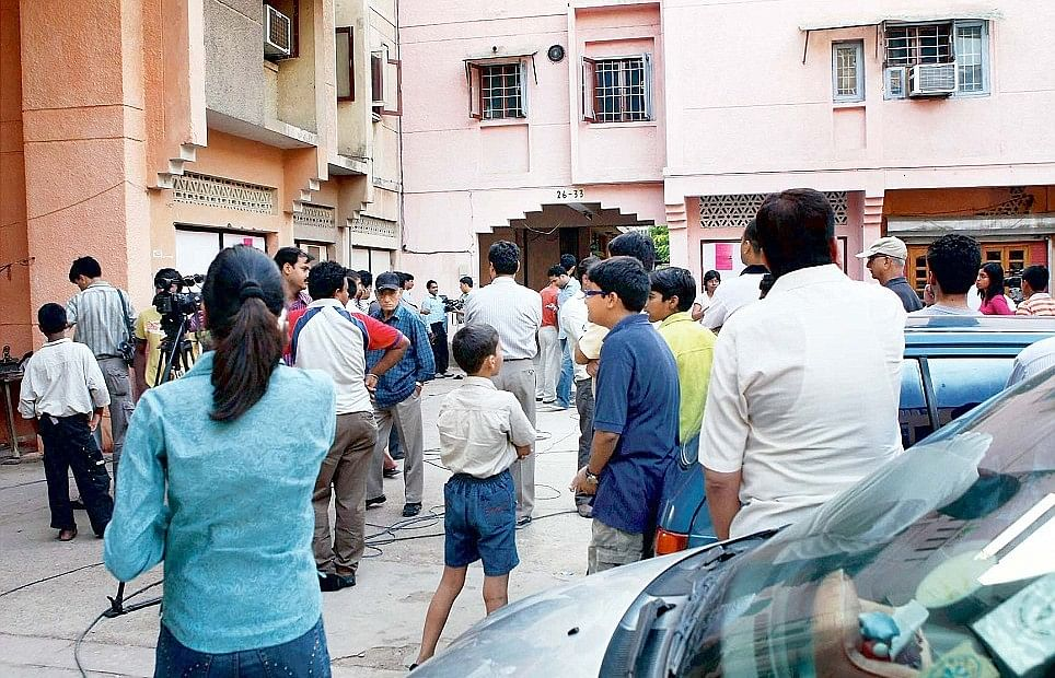 Jal Vayu Vihar residents and media outside the Talwars' residence in Noida after Aarushi's murder on 16 May 2016.