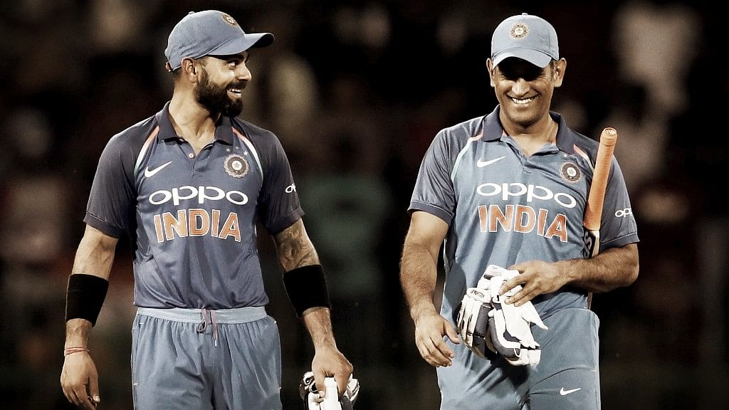 Virat Kohli (L) and MS Dhoni (R) walk back to the pavilion after leading India to victory in an ODI.