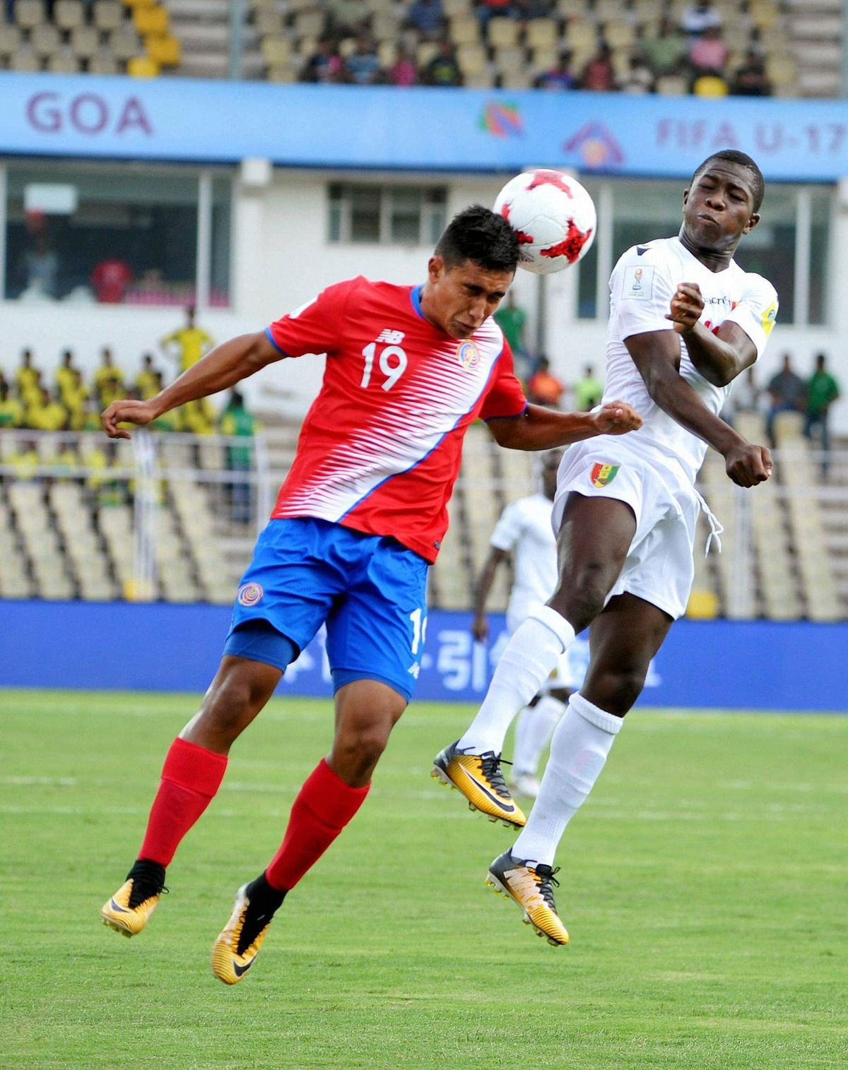 Players of  Costa Rica and Guinea vie for the ball during their U-17 FIFA World Cup football match at Pandit Jawaharlal Nehru Stadium, Goa.