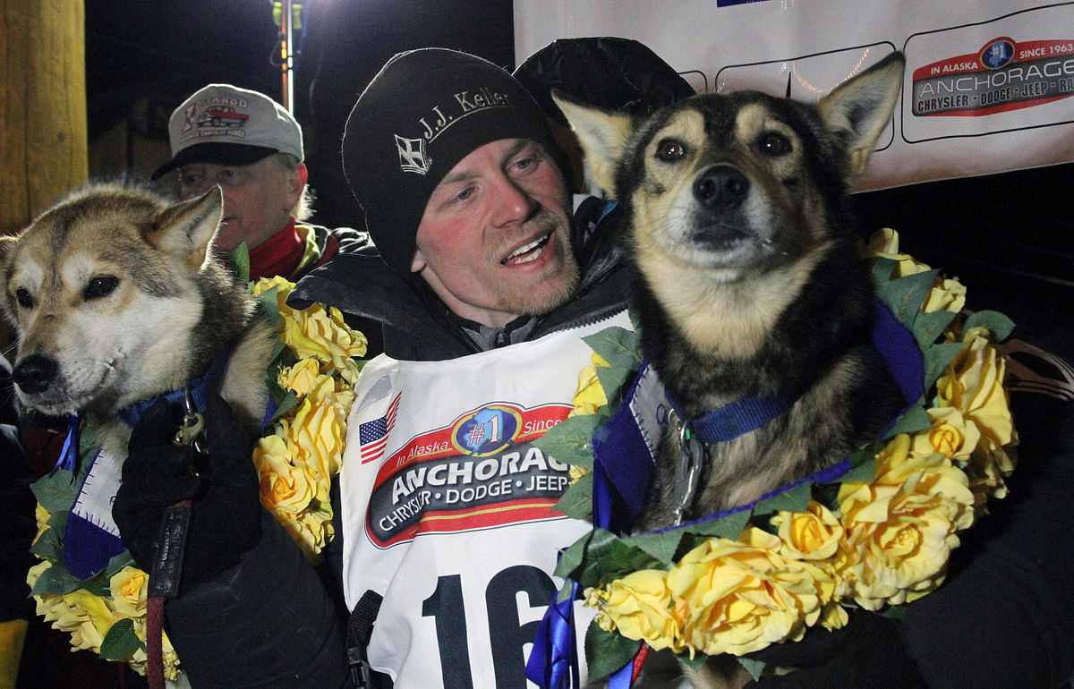 In this March 15, 2016, file photo Dallas Seavey posing with his lead dogs Reef, left, and Tide after finishing the Iditarod Trail Sled Dog Race in Nome, Alaska.&nbsp;<a></a>