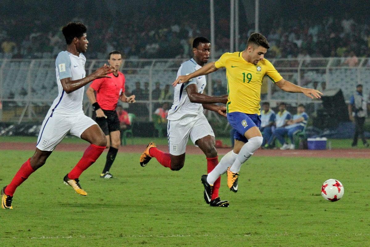 Brazil's Yuri Alberto controls the ball past England's Marc Guehi.