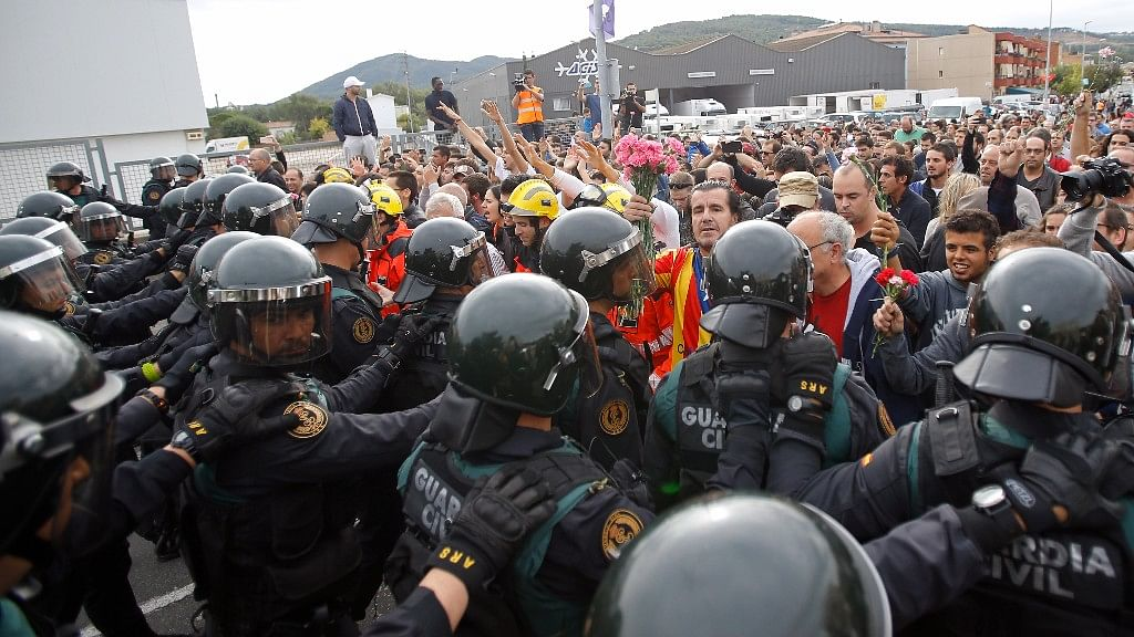 People block the street in a stand off with civil guards in Sant Julia de Ramis, near Girona, Spain, Sunday, on October 1, 2017.