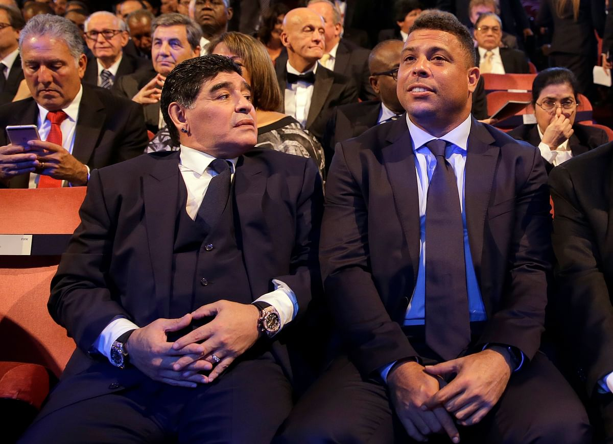 Argentinian soccer legend Diego Armando Maradona, left, sits beside Brazilian soccer legend Ronaldo during the The Best FIFA 2017 Awards at the Palladium Theatre in London.