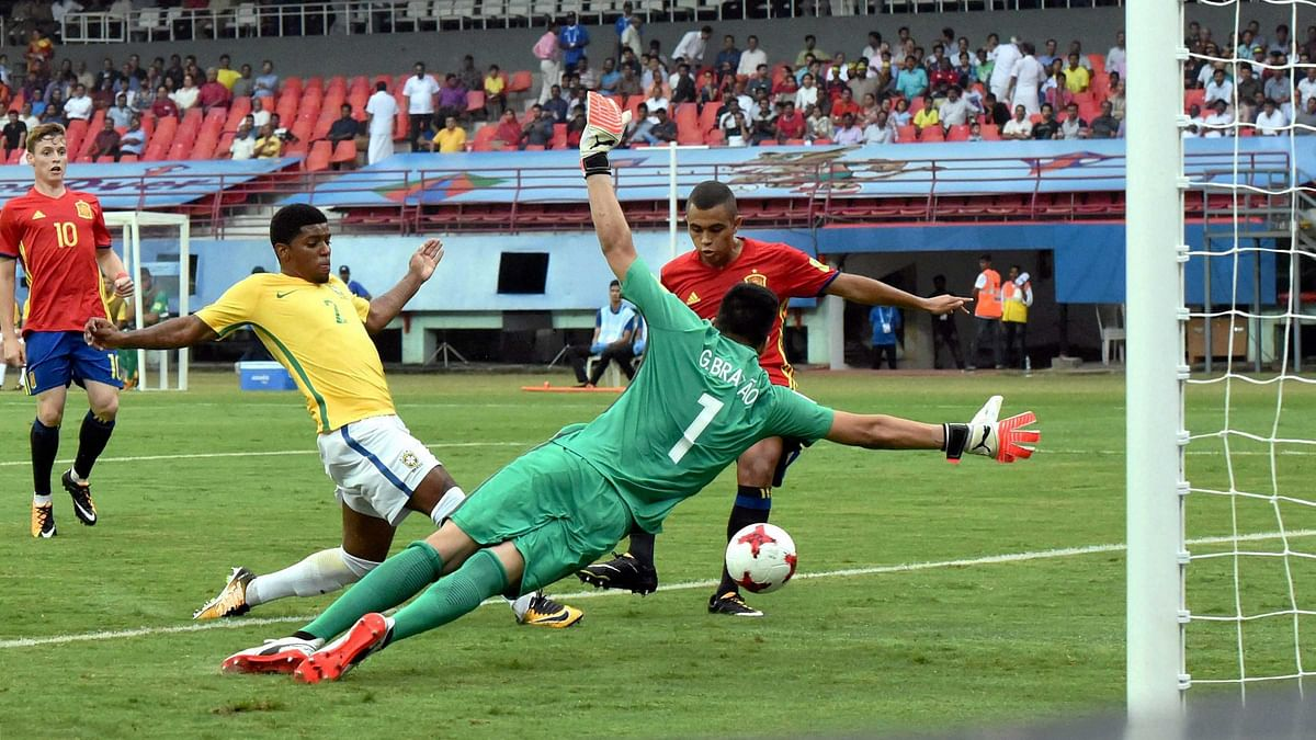 Kochi: Spain's Mohamed Moukhliss, in red, scores a goal against Brazil during their U-17 FIFA World Cup match in Jawaharlal Nehru International Stadium