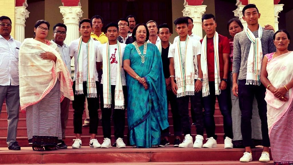 Imphal: Manipur Governor Najma Heptulla with the players of Indian FIFA U 17 World Cup 2017 during a felicitation ceremony in Imphal on Oct 16, 2017.