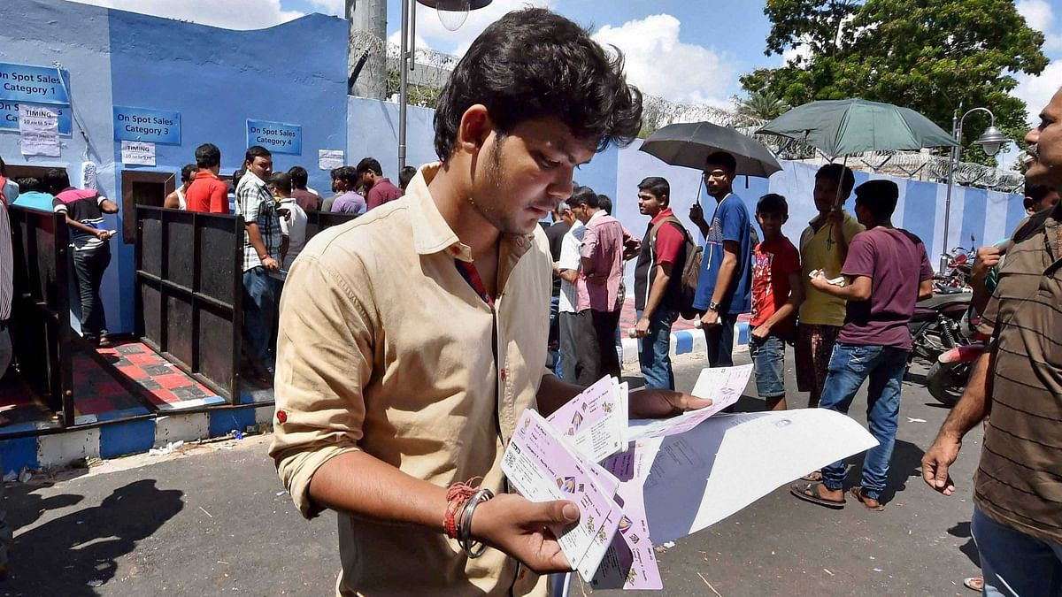 A man walks away after buying his tickets for the FIFA U-17 World Cup at the Salt Lake in Kolkata