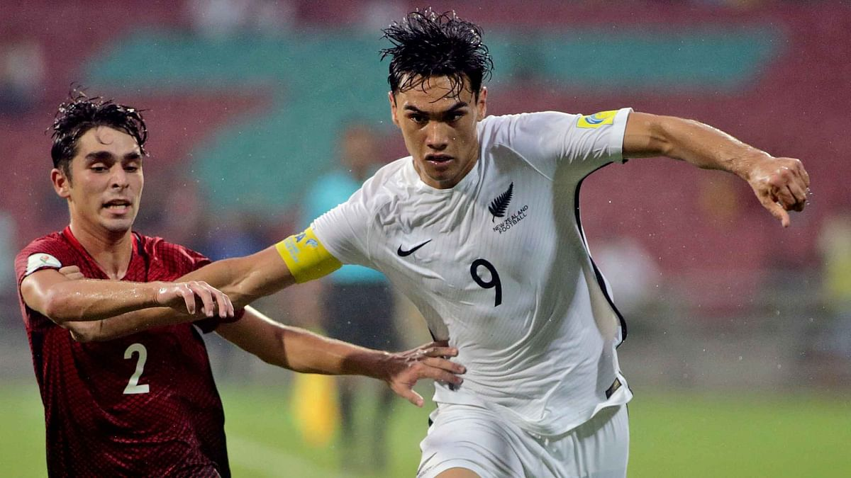 New Zealand's Max Mata fights for the ball with Turkey's Emirhan Civelek.