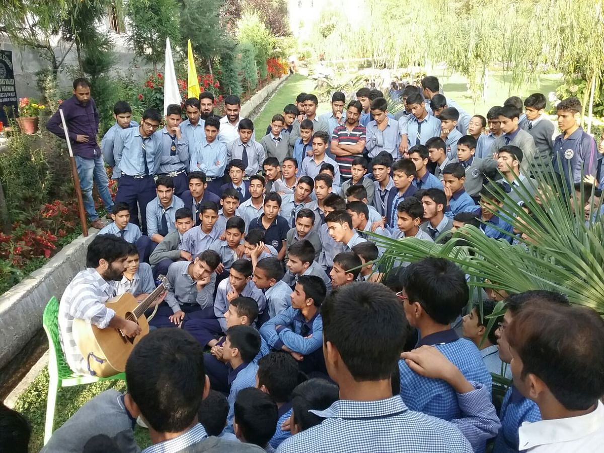 Musician Ovais Ahmad performs at Scholars Boarding School, Harwan, on the International Day of Peace.