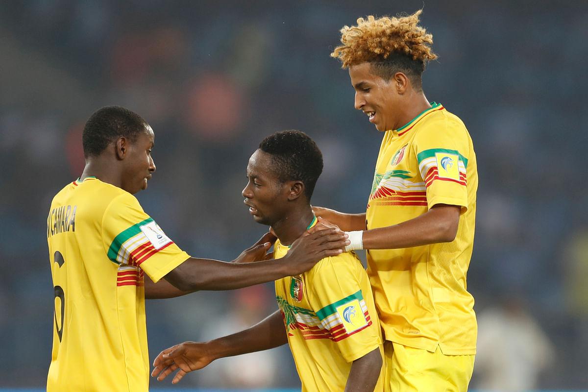 Mali's Djemoussa Traore celebrates a goal with his teammates.