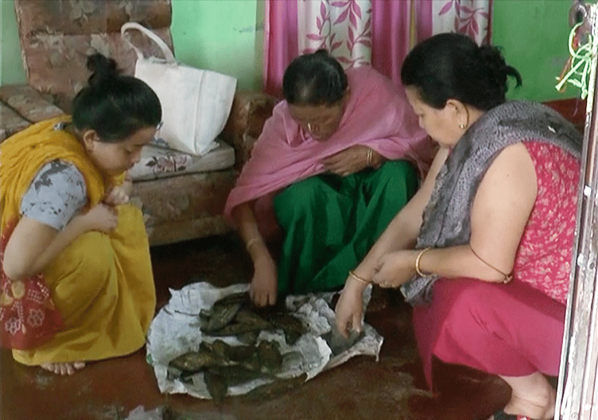 Amarjit's mother sells fish in Imphal to support her son.