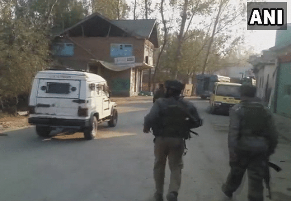 Security personnel assemble in Pulwama.