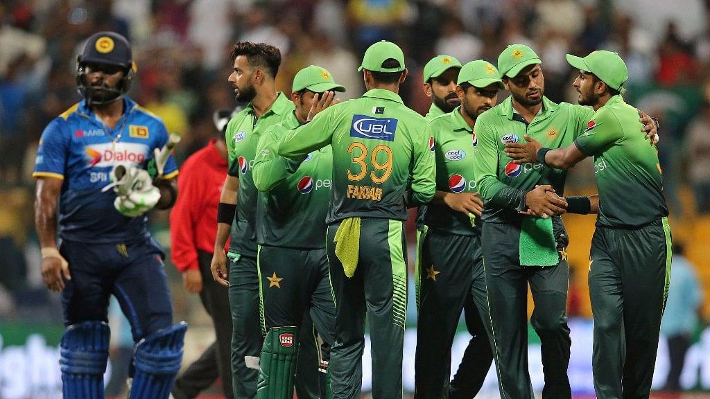 Pakistan's players celebrate dismissal of Sri Lanka's Vikum Sanjaya during their first T20I cricket match in Abu Dhabi.
