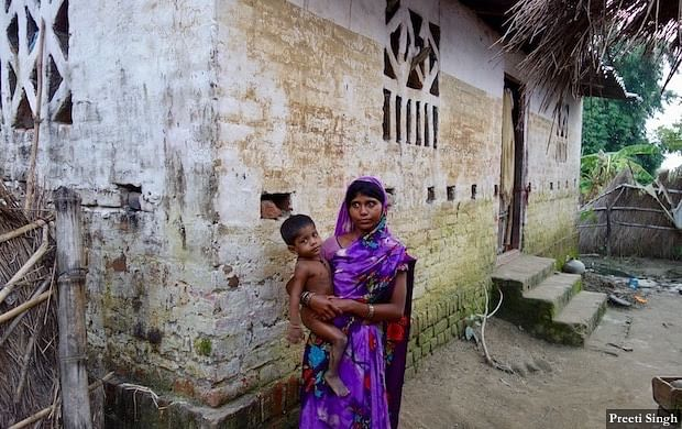 Chanda Devi of Marjadi was caught in the rising flood water along with her two young children. They were rescued by fellow villagers as water level crossed 6-feet (mark on the wall of the house) in the village.