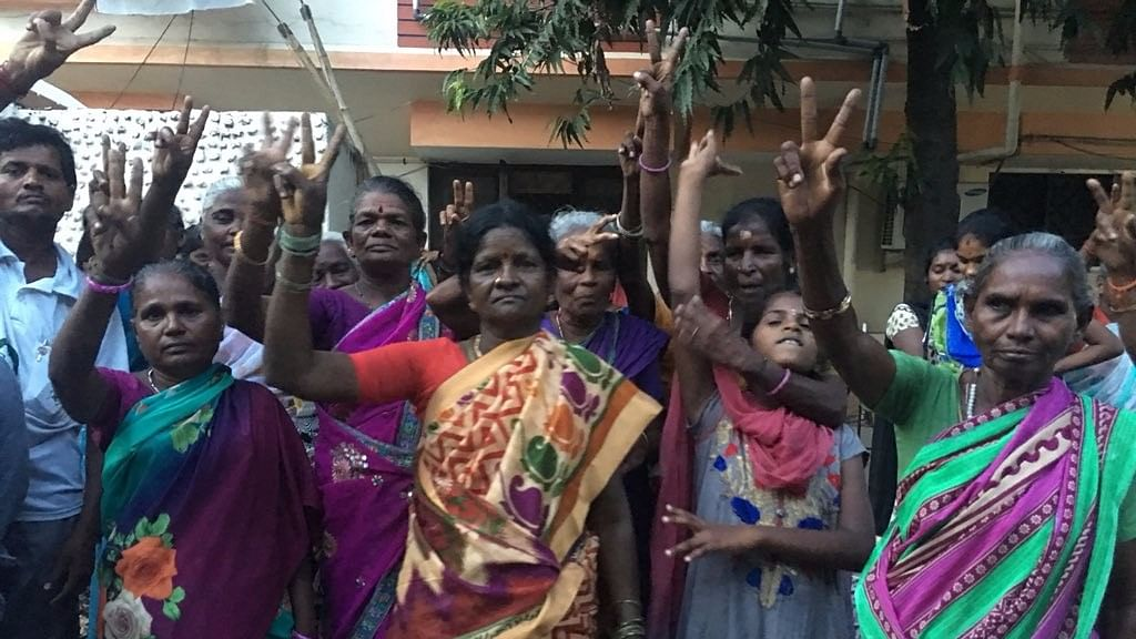 Supporters lined up outside the residence where Sasikala will be staying at during her emergency parole.
