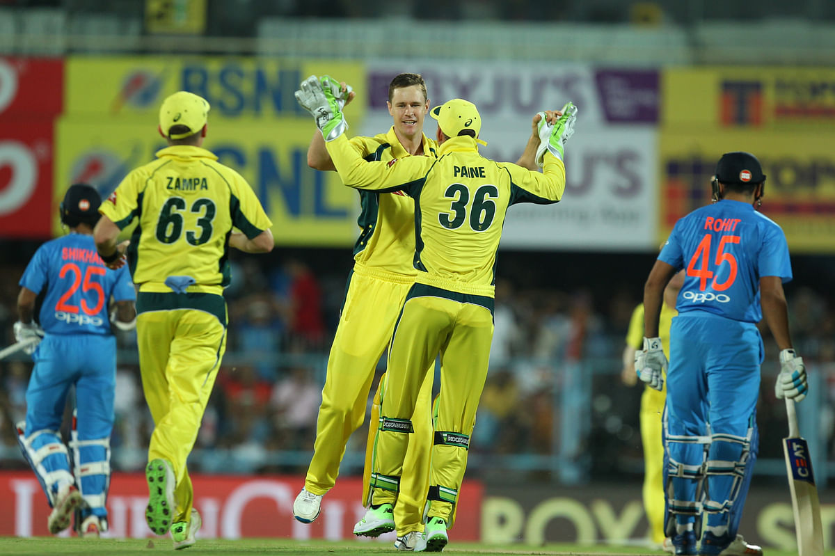 Jason Behrendorff celebrates a wicket with his teammates during the second T20 against India.