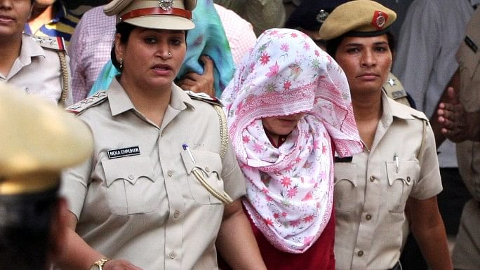 Honeypreet Insan, head covered with scarf, leaves after being produced in court in Panchkula.