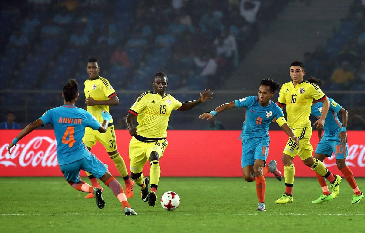 India and Colombia players in action.