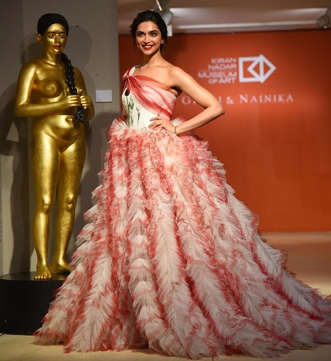 Deepika in the one shoulder gown designed by Gauri & Nainika.