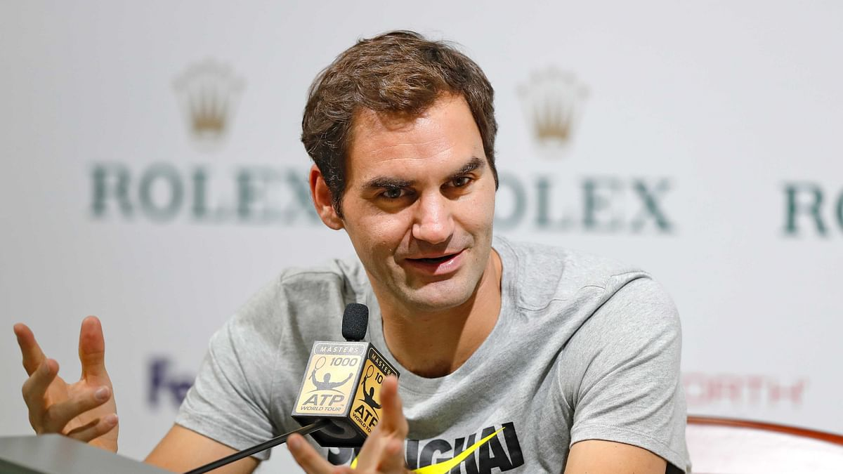 Roger Federer of Switzerland speaks during a news conference for the Shanghai Masters tennis tournament at Qizhong Forest Sports City Tennis Center in Shanghai, China