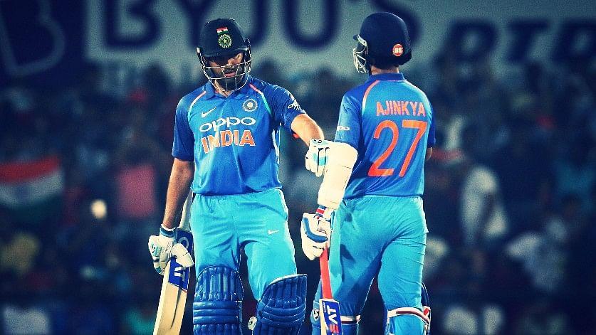 Rohit Sharma and Ajinkya Rahane share a moment in the