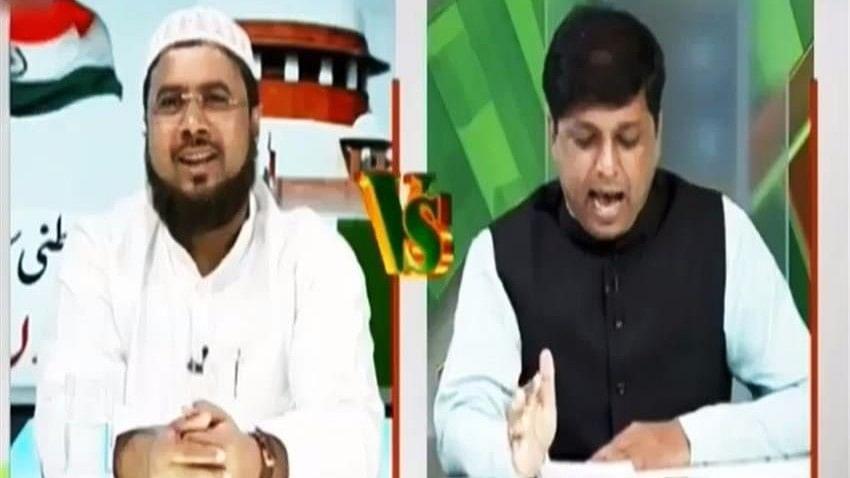 AIMPLB leader Mufti Ejaz Arshad Qasmi and BJP spokesperson Navin Kumar Singh on a television debate.