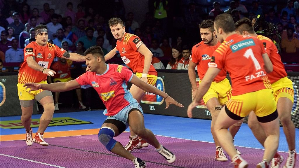 Players of Jaipur Pink Panthers and Gujarat Fortunegiants in action during the Pro Kabaddi League match at Sawai Mansingh Indoor Stadium in Jaipur on Friday.