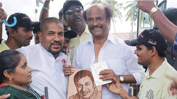 A file photo of Rajinikanth meeting his fans in Chennai.