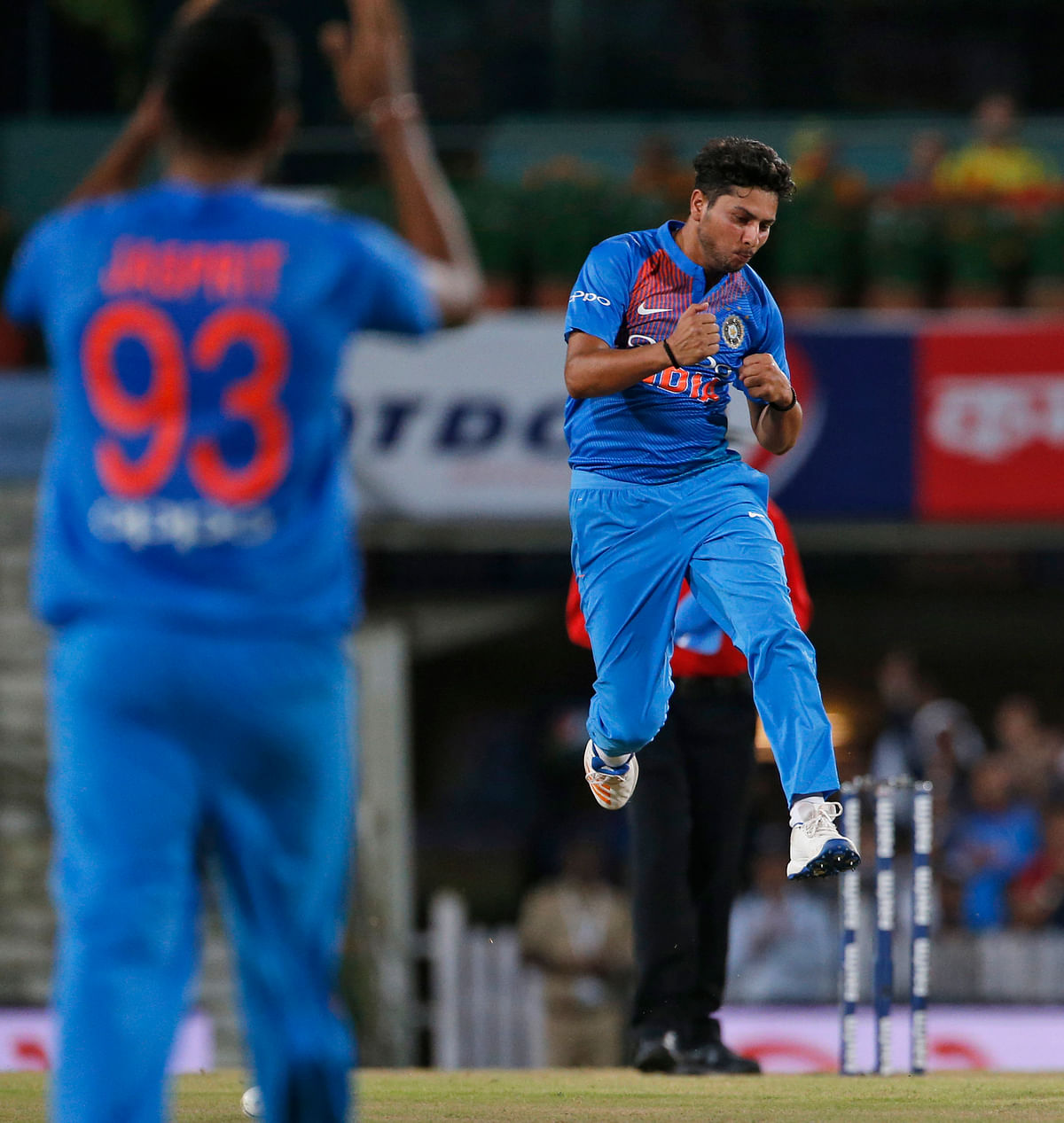 India's Kuldeep Yadav leaps in air as he  celebrates the wicket of Australia's Aaron Finch during their first T20 cricket match in Ranchi