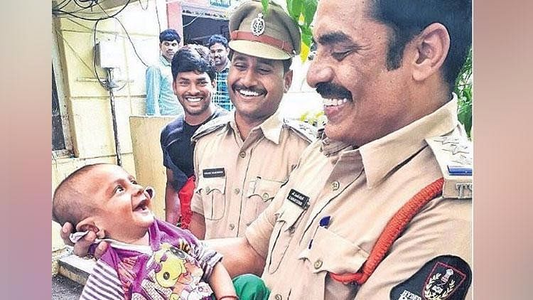The photo of the child grinning at a city cop who rescued him has gone viral.