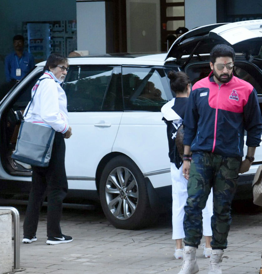 Amitabh and Abhishek before they enter the airport.