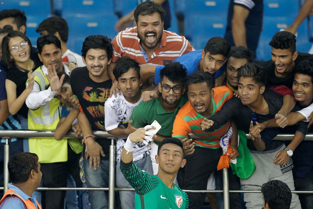 Dheeraj Singh take a picture with fans in New Delhi. (Photo: AP)