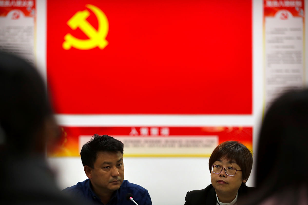 Participants attend a meeting of a residential community during a media tour highlighting the Communist Party's efforts at the grassroots level in Beijing. <i>(Photo: AP)</i>
